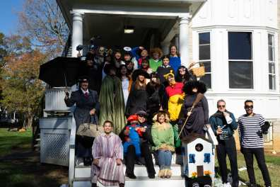 Everyone in costume at the picnic gathered on the back steps of 189 W. Main Street