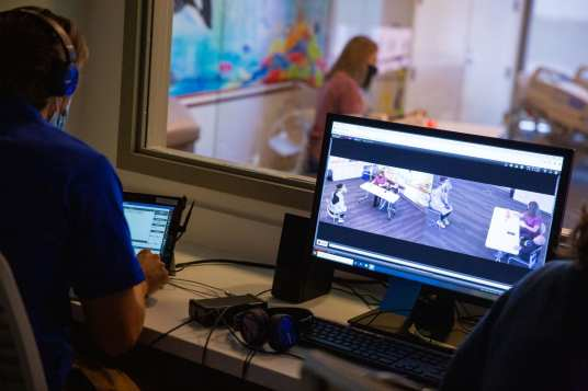Communication Sciences & Disorders master's students participate in a simulation in the Tower at STAR.