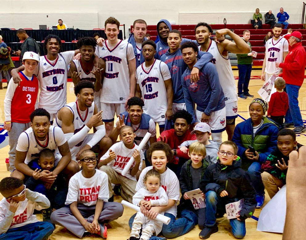 Detroit Mercy Basketball team with fans