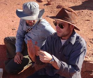 Detroit Mercy professor Nizar Ibrahim (right) examines a fossil with Diego Mattarelli.