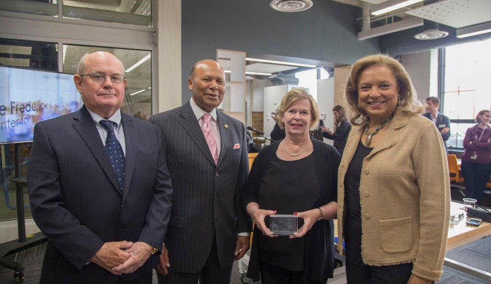 Left to right: Frederick Seibert '69, Dr. Antoine M. Garibaldi, Suzanne Seibert and Carol Garibaldi pose for a photograph during the opening of the Frederick and Suzanne Seibert Center for Innovation and Collaboration.