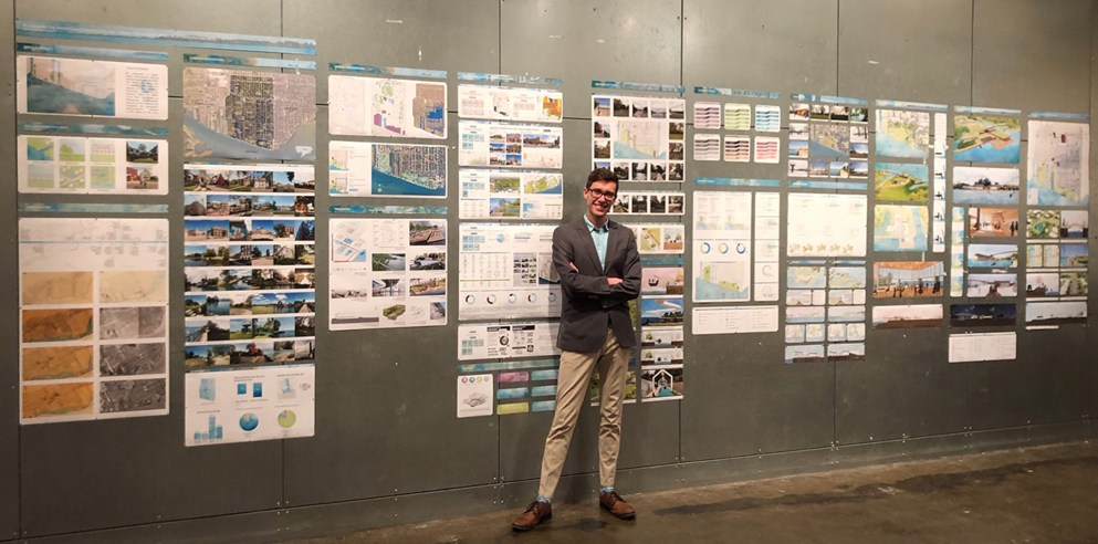 Architecture student Matthew Northcott posing with his final critique.