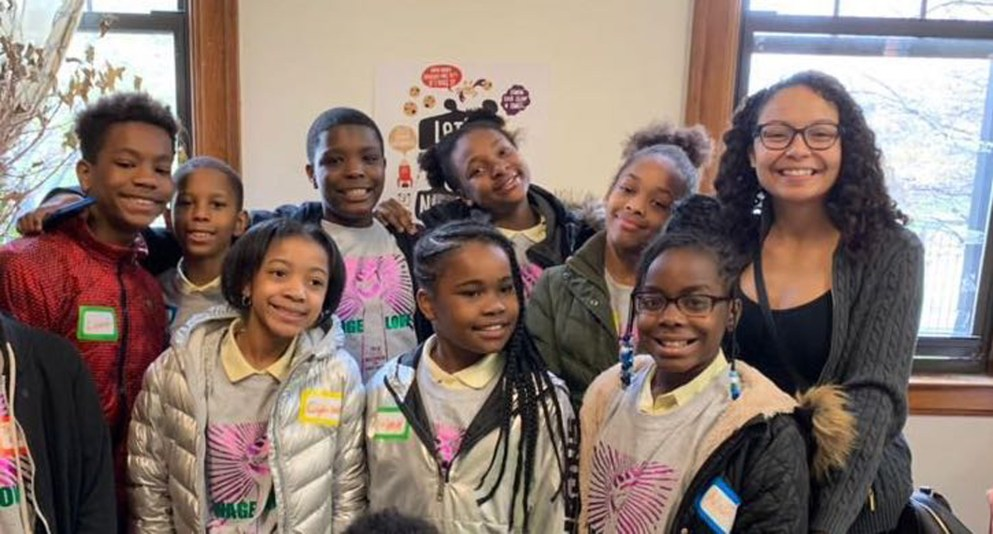 Chanel Smith is surrounded by Detroit Public School 5th Graders on Better World Day, May 3, 2019. Chanel helped 5th grade students at Burns, Noble, Maybury, and Spain Elementary Schools organize book drives to support four local organizations: Brilliant Detroit, Detroit Hives, Caught Up, and We Found Hip Hop.