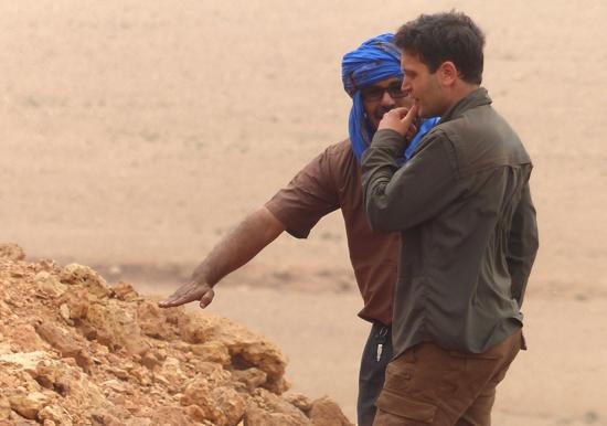 Nizar Ibrahim contemplates his next move while exploring a dig site in the Sahara Desert.