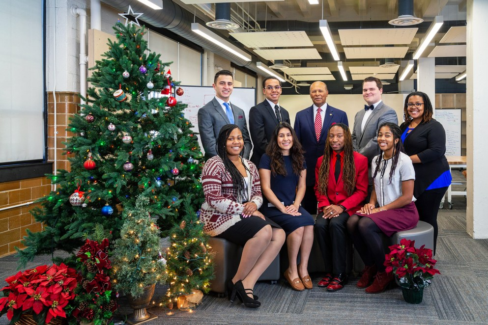 President Antoine M. Garibaldi, Ph.D., (center) with Detroit Mercy students in the Frederick & Suzanne Seibert Center for Innovation & Collaboration, located in the College of Engineering & Science.