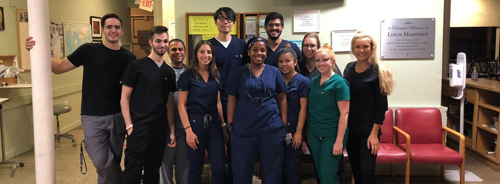 Dental students pose for a photo.
