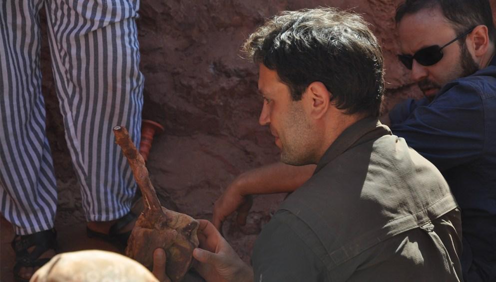 University of Detroit Mercy professor Nizar Ibrahim holds new fossil.
