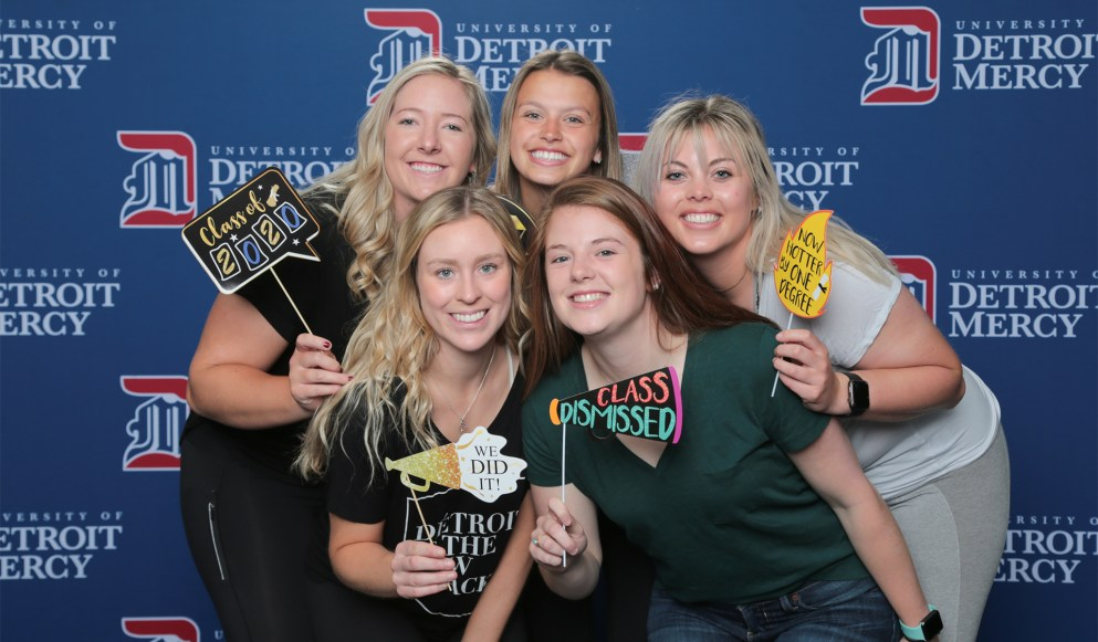 A group of Detroit Mercy Class of 2020 graduates celebrating at Grad Salute.