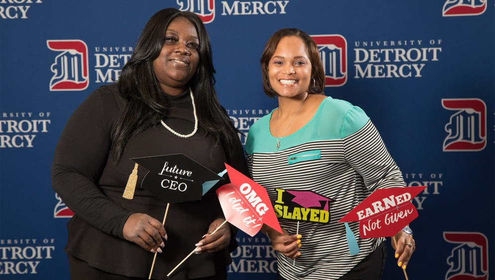 Pictured right, Victoria Ryce celebrates with fellow graduating student Nicole Greene at Grad Salute in March.