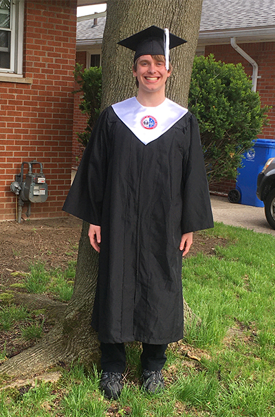 Dan Doyle in a grad cap and gown