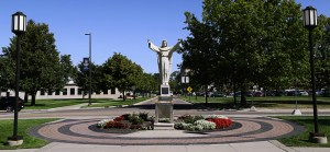 Detroit Mercy McNichols Campus Jesus Statue and road.