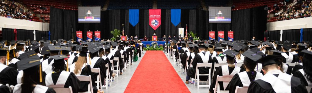 Commencement red carpet and Detroit Mercy graduates with caps and gowns
