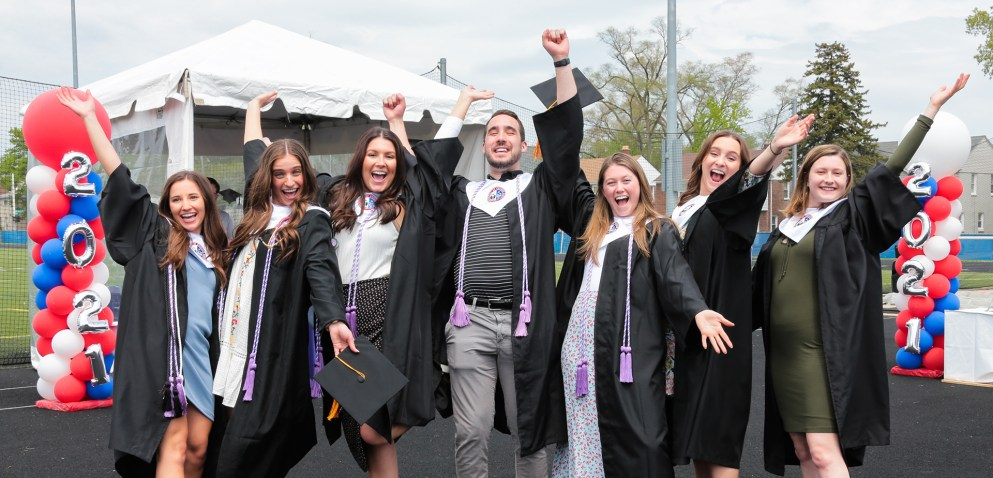 Class of 2021 students throw their hands up in excitement!