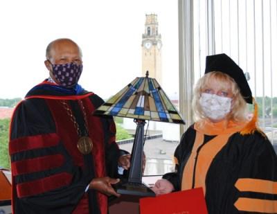 Maureen Murphy accepts their award from Dr. Garibaldi.