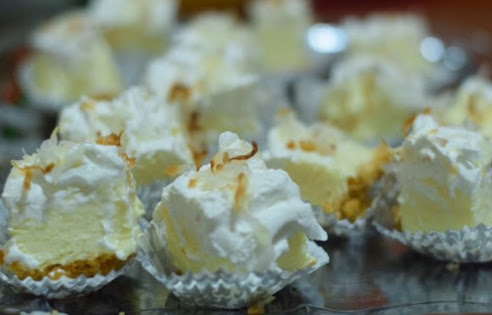 Bites&Booze. Creamy coconut filled cheesecake topped with toasted coconut