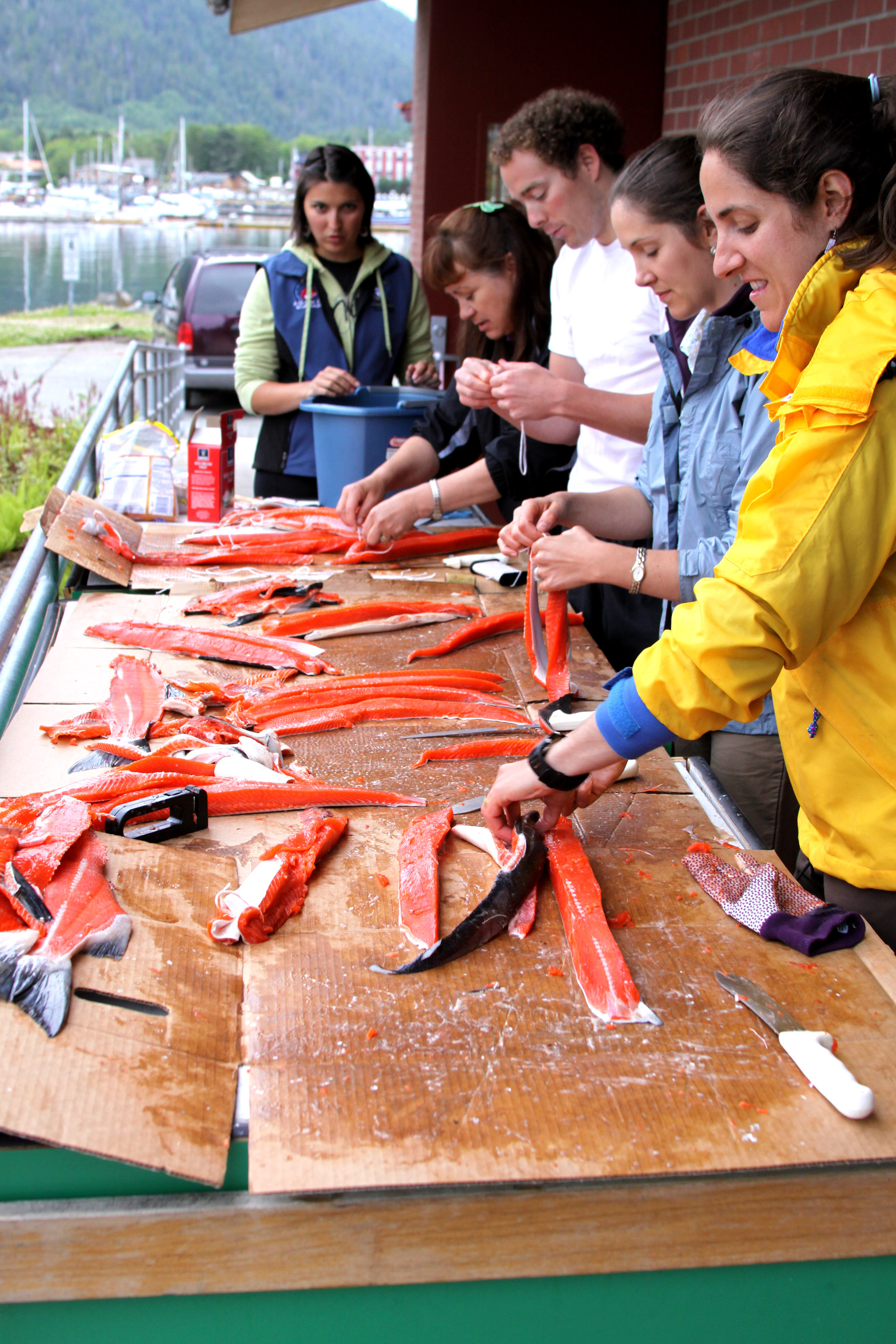 ANSWER Camp teachers Adriana Rodriguez, left, Alberta Demantle, Jordan Baumgartner, Collauna Marley and Chohla Moll prepare sockeye salmon for the smoker Wednesday night so it will be ready when the students arrive in Sitka on Friday.