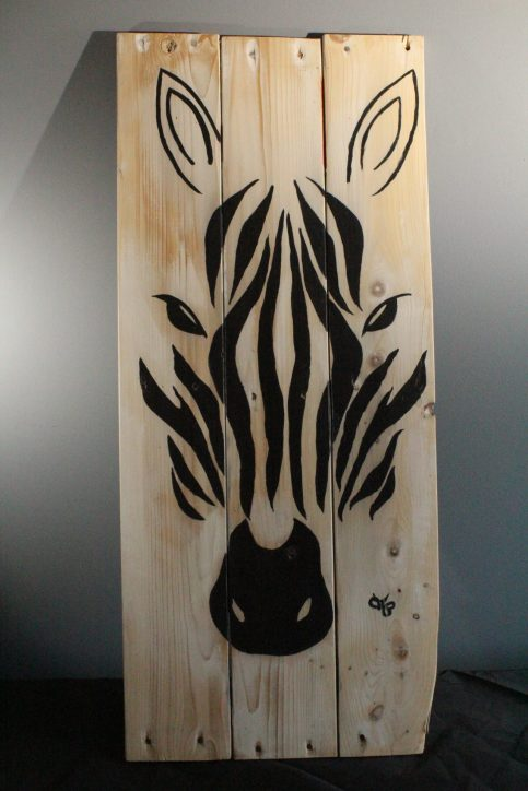 Zebra painted on wooden slats