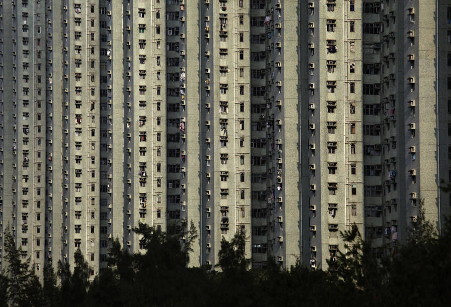 Public housing blocks are seen at Ma On Shan in Hong Kong's rural New Territories September 9, 2011. This southern Chinese city is described as a concrete forest, famous for the number of high rise commercial and residential towers. About 25 percent of the world's tallest 100 residential buildings that stand at least 200 meters tall are in the territory. The world's population is projected to reach 7 billion on October 31, according to official U.N. population projections, presenting what the United Nations Population Fund called both a challenge and an opportunity. Picture taken September 9, 2011. REUTERS/Bobby Yip (CHINA - Tags: CITYSPACE SOCIETY) - RTR2SM68