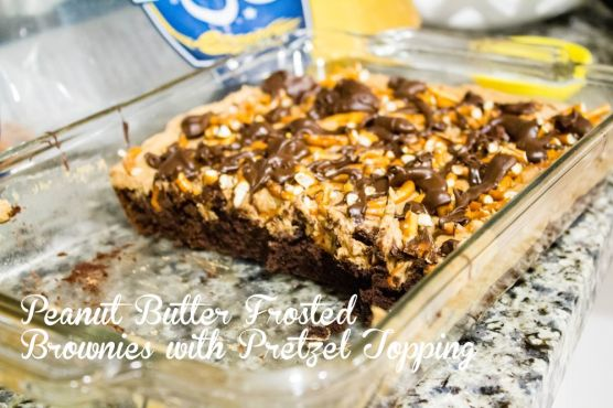 Peanut Butter Frosted Brownies with Pretzel Topping on Sixat6