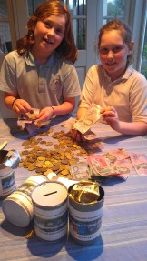 Our youngest girls counting the funds to give to people in need in Myanmar.