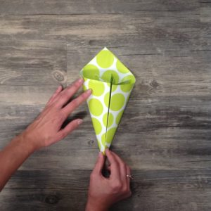 Paper Flower Origami   Folded Flower Tutorial   Origami Flower   Flower Party Decor These flowers can be made from scrapbook paper or wrapping paper to match your party or wedding decor. Simple and economical, and you can make them big or small for whatever you need them for!   Six Clever Sisters