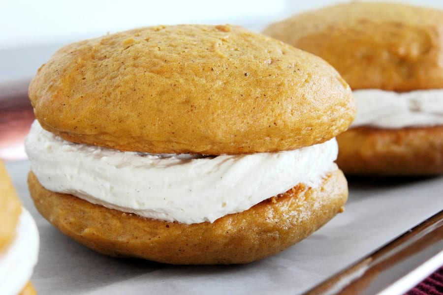 Pumpkin Spice Whoopie Pies Recipe - If you adore pumpkin spice recipes, be sure to pin this! These pumpkin spice whoopie pies are the perfect combo of pumpkin spice and sweet! They're your new favorite dessert!