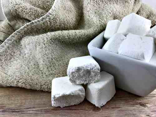 Love how easy detergent tablets make doing laundry but hate the cost? Give these homemade laundry detergent tablets a try! They're easy to make, clean better than store bought and are super cheap to make!
