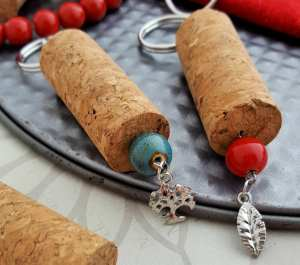 Have a few wine corks lying around? Make this simple wine cork craft! These wine cork key chains work up super quick and are sure to be loved by anyone! Customize in any color or with any charms you want!