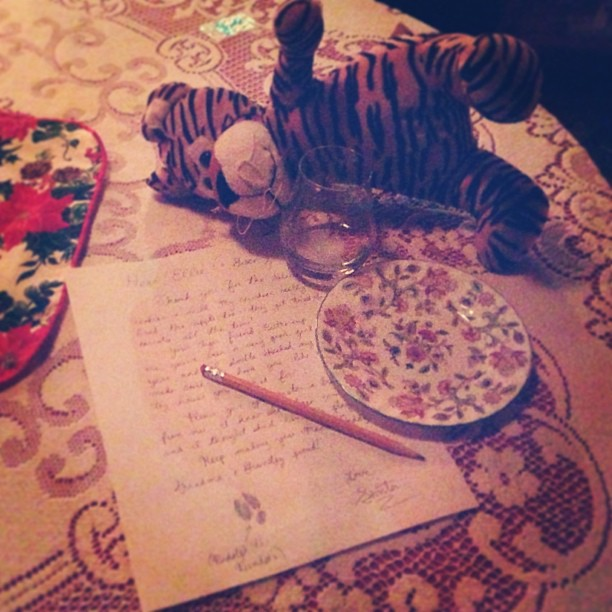 Santa's handwriting looks a lot like Mama's. Buttercup passed out waiting for Santa.