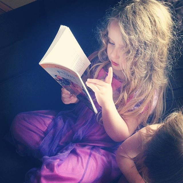 Reading her chapter book all on her own!