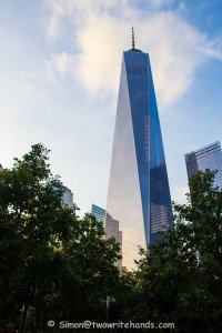 "The New ""Freedom Tower"" Seen Through the Trees Surrounding the 9/11 Memorial"