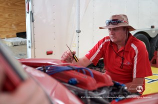 Garry Orton helping adjust the tune. Photo by Mike Wilson ©2012. All Rights Reserved.