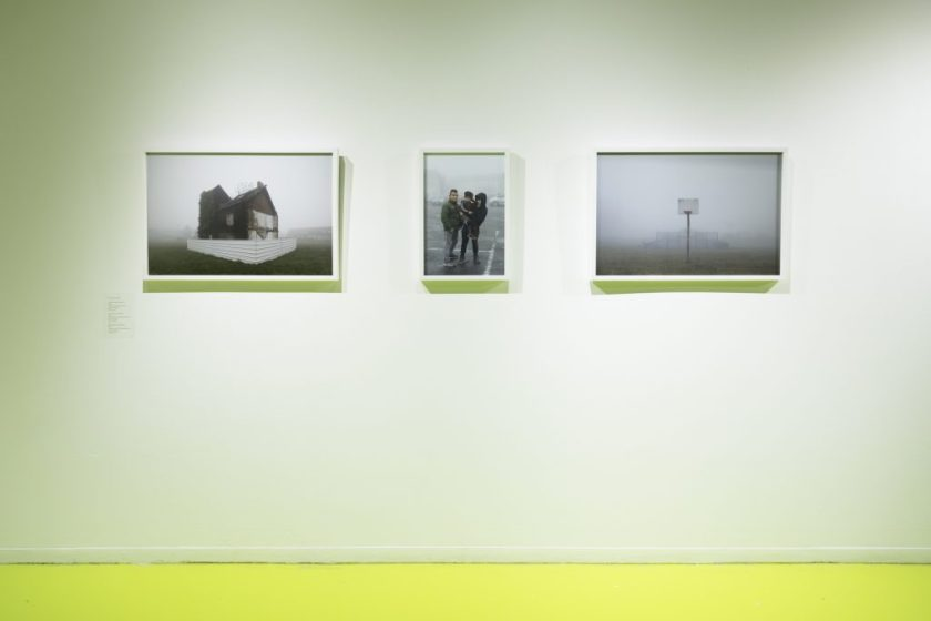 A photographic triptych from David Schalliol's Mining Basin (Hauts-de-France), showing an abandoned house shrouded in fog, a couple with their child in a parking lot, and an isolated basketball hoop. Photo courtesy of Hyde Park Art Center.