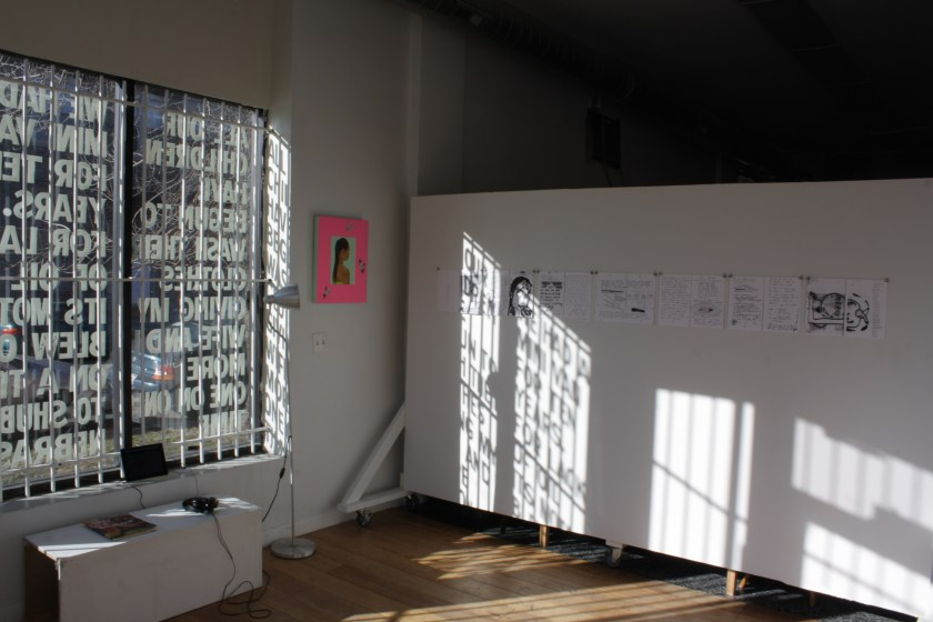 "An installation view of the recently closed show at Hume, ""Feeling Pink Like My Insides."" Light streams through a window covered by letter that make up part of a semi-permanent installation by Alberto Aguilar. On the walls hang works by Ari Brielle and Caroline Hicks. Photo by Hannah Siegfried"