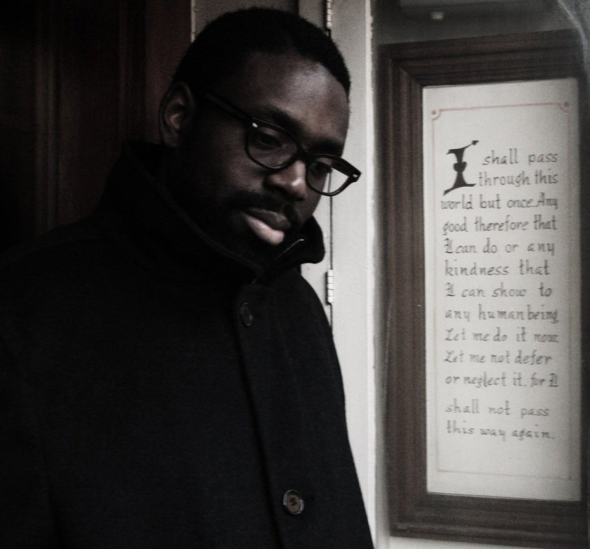 "The album cover for ""Starfish Time"" is a photograph that shows the artist, as a younger man, on the left side of the image and, on the right side, script within a brown wooden frame. The artist wears black glasses and a black coat that is buttoned all the way up. He tilts his head toward the camera and looks toward the ground. The text reads: ""I shall pass through this world but once. Any good therefore that I can do or any kindness that I can show to any human being, let me do it now. Let me not defer or neglect it, for I shall not pass this way again."" Courtesy of the artist."