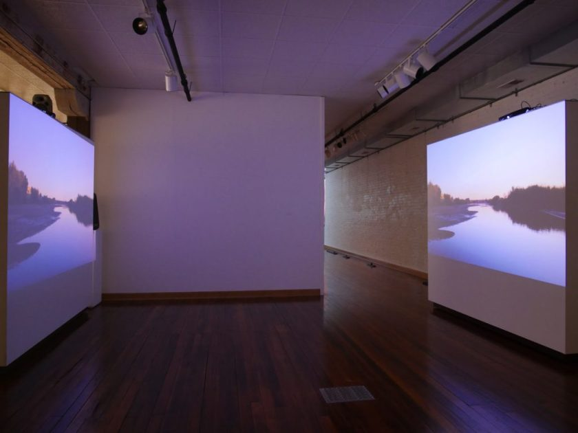 A two-channel video installation shows the riverbed of the Rio Grande, which helps mark the U.S.-Mexico border by Allison Walsh and Alexis Carballido, 2018. Image courtesy of the artists.