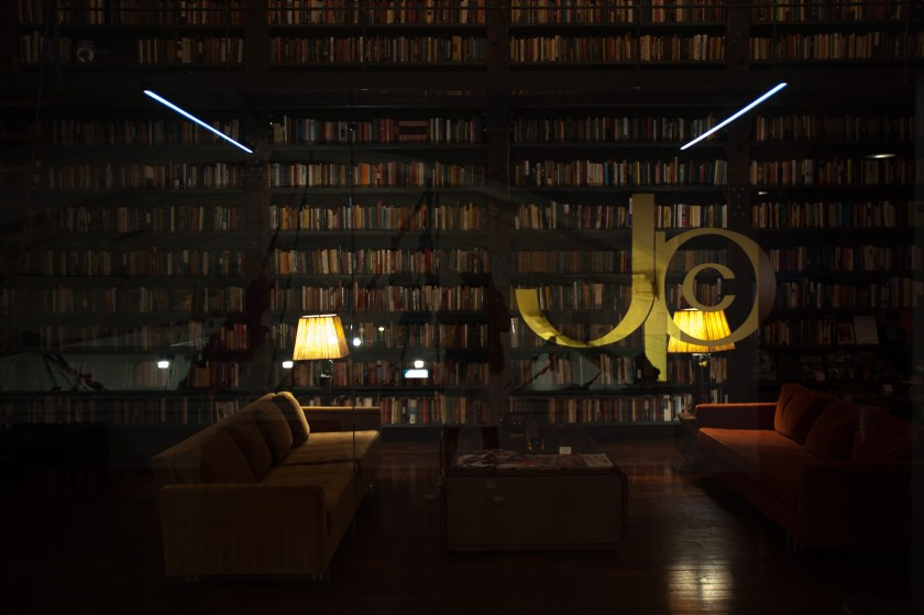 "Image: The Johnson Publishing Company's logo etched into the glass wall of ""The Johnson"" reading room and lounge, housing thousands of books, artwork, and original furnishings from the company's archive included in A Johnson Publishing Story exhibition. Photo by Tony Smith."