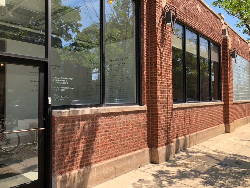 Image: An external shot of Chicago Artists Coalition. The building is made up of red bricks and large, rectangular windows. The entryway of the gallery can be seen through the front door. The sun is shining and the windows reflect the blue sky and leafy green trees that line the sidewalk. Photo courtesy of Chicago Artists Coalition.