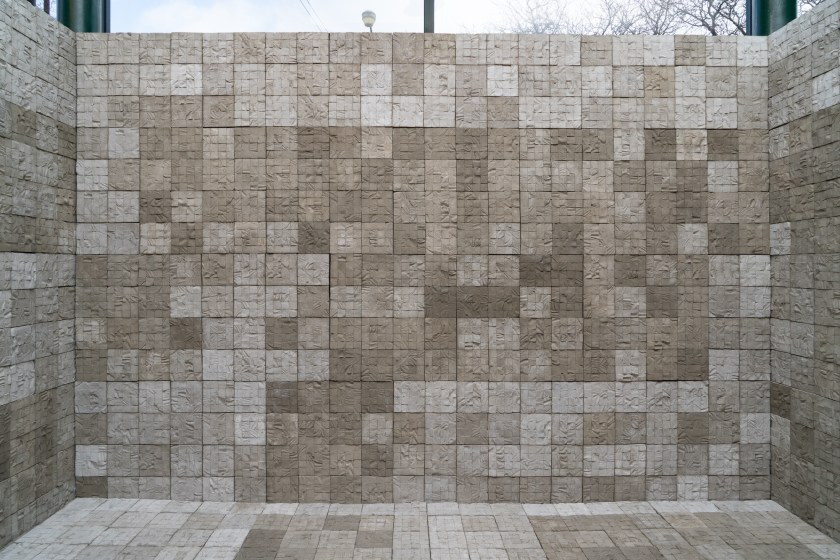 Image: Selva Aparicio, Entre Nosotros (Among Us), 2020. Concrete tiles cast from human cadavers. The image shows the piece installed. Various tones of grey, concrete blocks form a grid on three sides like walls, as well as an additional fourth side as a floor. Photo: Robert Chase Heishman. Image courtesy of the artist.