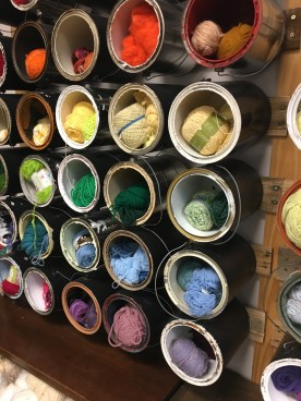 Yarn wall using old paint cans.