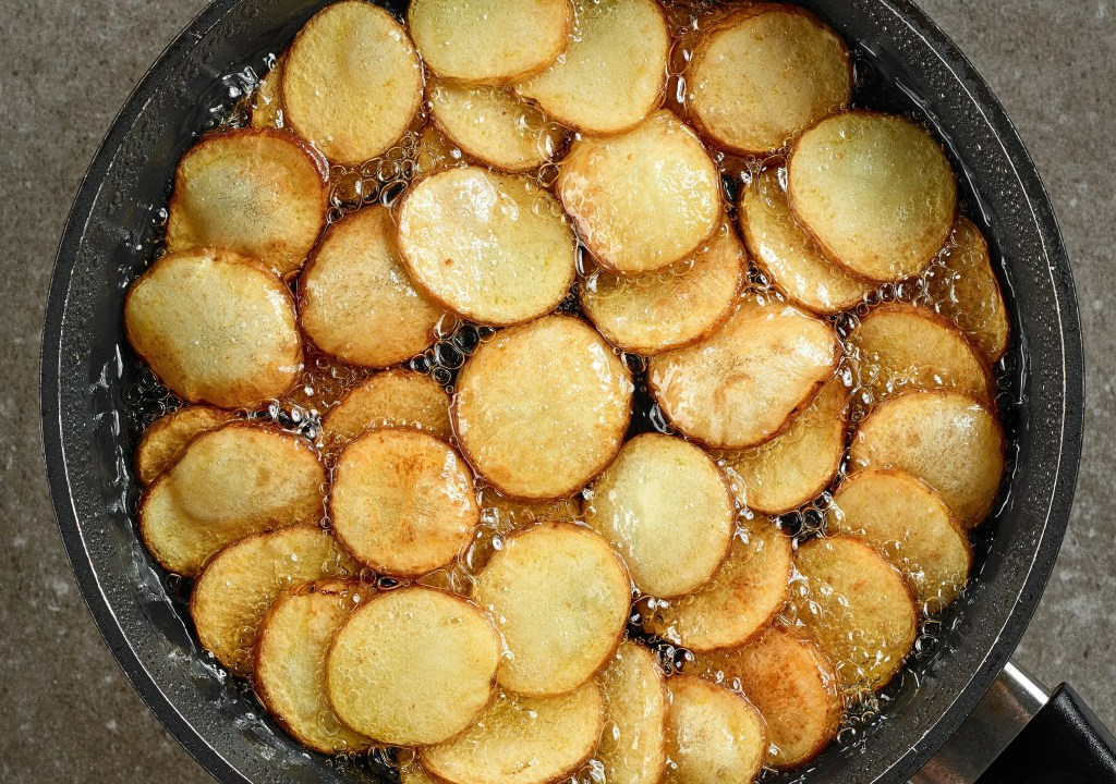 Simple Deep Frying Oil Solution if you Only Deep Fry a Couple Times a Year frying potatoes in pan with oil 37FVCXB