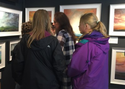 Students in the Gallery listening to artist Sarah Jane Brown talking about her work.