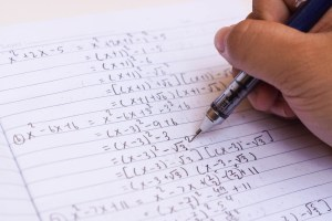 A student solves algebra equations