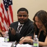 Reynolds Wintersmith, left, whose his life-plus-40-year sentence for a nonviolent drug crime was commuted by President Barack Obama last December, listens as Serena Nunn describes her proudest moments since her own sentence was commuted.