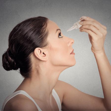 SjogrensLife Woman putting in Eyedrops for Dry Eyes