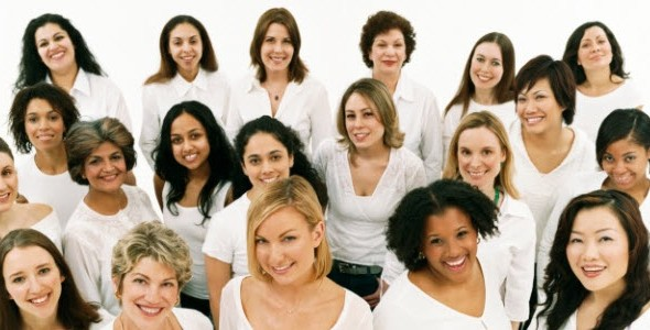A picture of women from many different backgrounds wearing white shirts.
