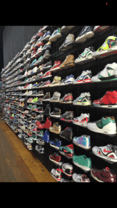A wall display of shoes.