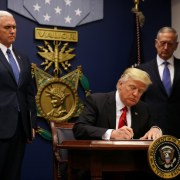 Trump signs revised travel ban order, leaves Iraq off