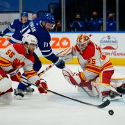 Flames douse Leafs in OT