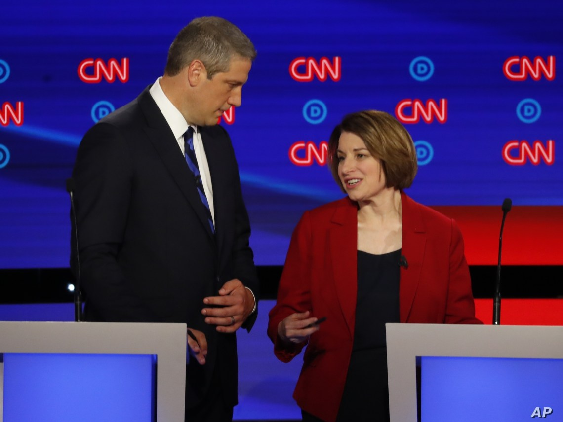 Rep. Tim Ryan, D-Ohio, and Sen. Amy Klobuchar, D-Minn. talk during a break in the first of two Democratic presidential primary debates hosted by CNN Tuesday, July 30, 2019, in the Fox Theatre in Detroit. (AP Photo/Paul Sancya)